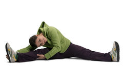 Sport girl stretching on floor Stock Photo