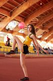 Sport girl in track and field athletics playpen. Sport girl in yellow suit pose in track and field athletics playpen royalty free stock image