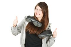 А sport girl with trainers on a neck Royalty Free Stock Photos