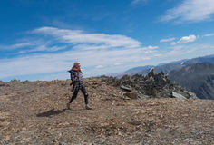 Sport girl walking in the mountains Stock Images