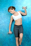 Sport girl in wear for fitness stands near blue wall Royalty Free Stock Photography