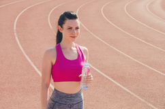 Sport girl workout. Exercise. Fitness. Health. Young  girl hold. Sport girl workout. Young  girl hold bottle of water at stadium do some training. Exercise Stock Photos