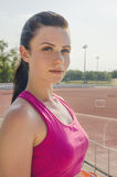 Sport girl workout. Exercise. Fitness. Health. Young  girl at st. Sport girl workout. Young  girl at stadium do some training and looking at camera. Exercise Stock Images