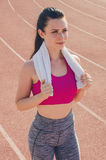 Sport girl workout. Exercise. Fitness. Health. Young  girl with. Sport girl workout. Young  girl with towel at stadium do some training. Exercise. Fitness Royalty Free Stock Photo