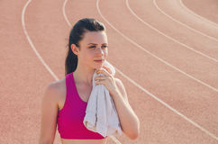 Sport girl workout. Exercise. Fitness. Health. Young  girl with. Sport girl workout. Young  girl with towel at stadium do some training. Exercise. Fitness Stock Photos