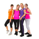 Sport girls. Group girls in colorful sportswear isolated over white background Royalty Free Stock Image