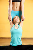 Sport girls doing stretching exercises. In gym Royalty Free Stock Photo