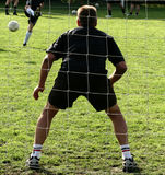Sport, goal keeper. Close up of people at sport, silhouette of a goalkeeper shot from behind royalty free stock photo