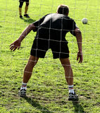Sport, goal keeper. Close up of people at sport, silhouette of a goalkeeper shot from behind stock image