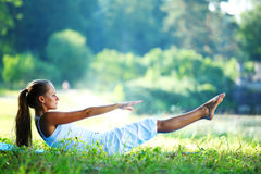 Sport on the groud. Woman lay and training on ground Stock Photography