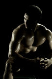Sport guy. Very power athletic guy rest  after execute exercise, on black background Stock Image