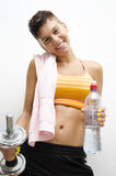 Sport, gym, girl holding weight and bottle of water Royalty Free Stock Photos