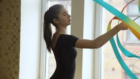 Sport gymnast ribbon artistic performance training. Sport athletics. gymnast calisthenics exercise training. ribbon artistic performance. young fit girl in a gym stock footage