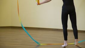 Sport gymnast ribbon artistic performance training. Sport athletics. gymnast calisthenics exercise training. ribbon artistic performance. young fit girl in a gym stock video