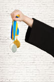 Sport .Hand holding gold medals after the victory .Award Winning. Hand holding gold medals after the victory royalty free stock image