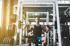 Sport handsome man doing exercises weight training,Cross fit body and muscular in the gym stock photo