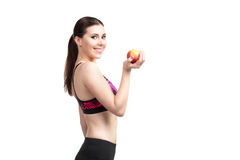 Sport happy girl with apple Royalty Free Stock Image