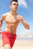 Sport and health body of young man running stock photography
