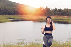 Sport and health lifestyle - young woman with bottle of drinking Royalty Free Stock Image