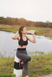 Sport and health lifestyle - young woman drinking water from a b Royalty Free Stock Photography