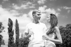 Sport and health. Woman and men drink water from bottle. Summer activity and energy. Girl and guy sunny outdoor. Couple of coach relax after workout Royalty Free Stock Photo
