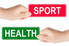 Sport and Health traffic sign in the hand Royalty Free Stock Photo
