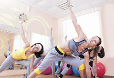 Sport and Healthlife Concepts. Group of Five Young Caucasian Females Making Stretching Exercises in Sport Class. Stock Images