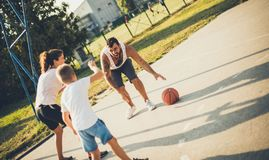 Sport and healthy life. Family playing basketball royalty free stock images