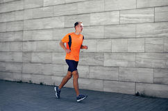 Sport and healthy lifestyle concept - fitness man running stock photography