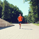 Sport and healthy lifestyle concept - fitness man running Stock Image