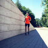 Sport and healthy lifestyle concept - fitness young man running Royalty Free Stock Photo