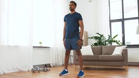 Indian Man Exercising And Doing Squats At Home Stock Video