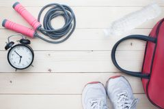 Sport and Healthy lifestyle concept with sport equipment and fit. Ness items on wooden background, Top view Royalty Free Stock Images