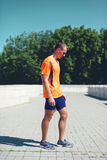 Sport and healthy lifestyle concept - sporty fitness runner man royalty free stock photo