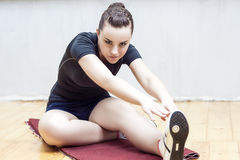 Sport Ideas and Concepts. Fit Woman Stretching Her Leg to Warm U Stock Photography