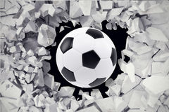 Sport illustration with soccer ball coming in cracked wall. Cracked concrete earth abstract background. 3d rendering Royalty Free Stock Images