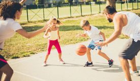 Sport is important in life. Family playing basketball together royalty free stock photo