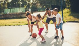 Sport is important in life. Family playing basketball royalty free stock photos