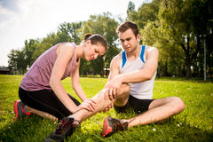 Sport Injury - helping hand Royalty Free Stock Image