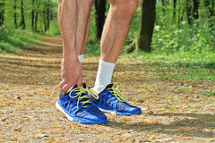 Sport injury, Man runner with ankle joint pain Stock Image