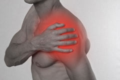 Sport injury, Man with shoulder pain. Pain relief concept Stock Images