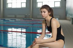 Sport injury. Woman feeling pain on her foot after swimming at swimming pool. Sport injury. Woman feeling pain on her foot after swimming at swimming pool Royalty Free Stock Images