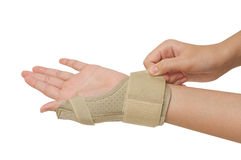 Sport injury, wrist with brace support Royalty Free Stock Image