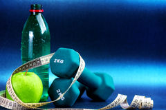Sport items  against blue background. Stock Photography