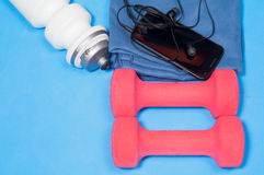 Sport items on the blue mat Royalty Free Stock Images