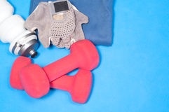 Sport items on the blue mat Royalty Free Stock Photo