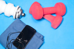 Sport items on the blue mat Stock Photography