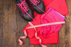Sport items on the wooden background Royalty Free Stock Image