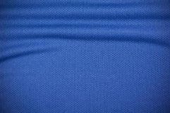 Sport jersey shirt clothing texture in blue. Blue sport jersey shirt clothing texture and background Stock Photos
