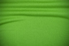 Sport jersey texture in green Royalty Free Stock Photography